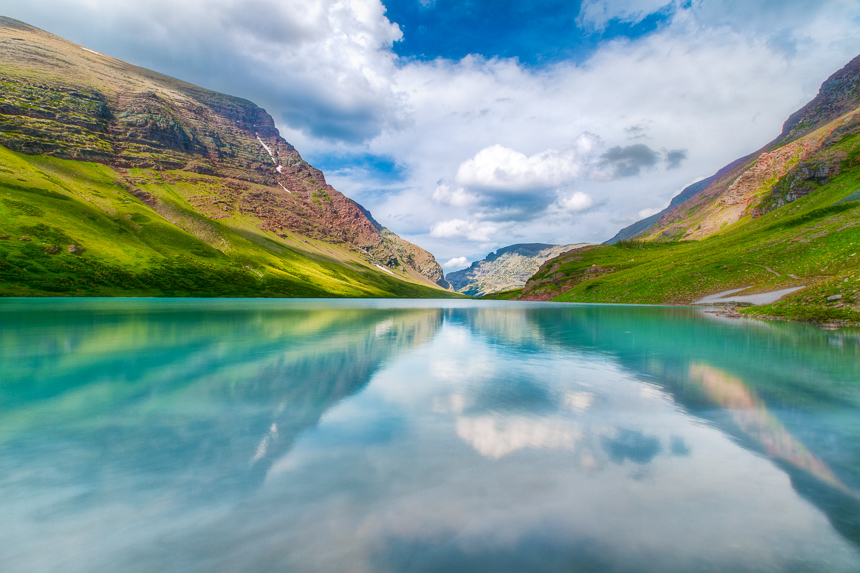 a photograph of craker lake in glacier national park