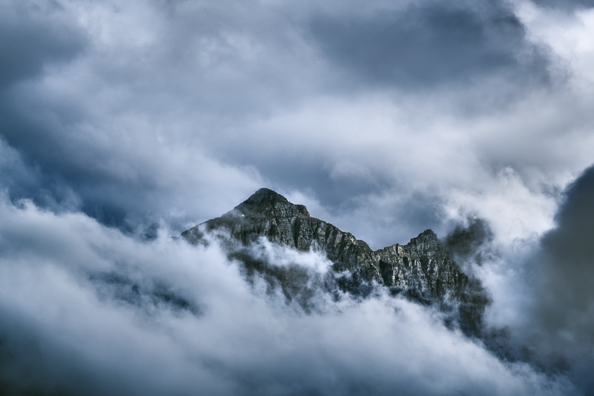 a photograph of Mt Cannon in the clouds in glacier national park montana
