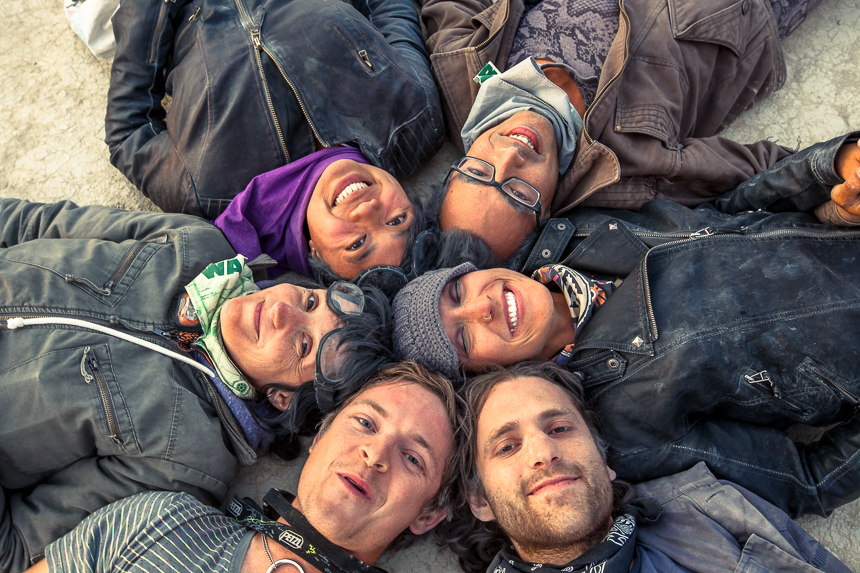photograph of people laying down in a circle at burning man 2013