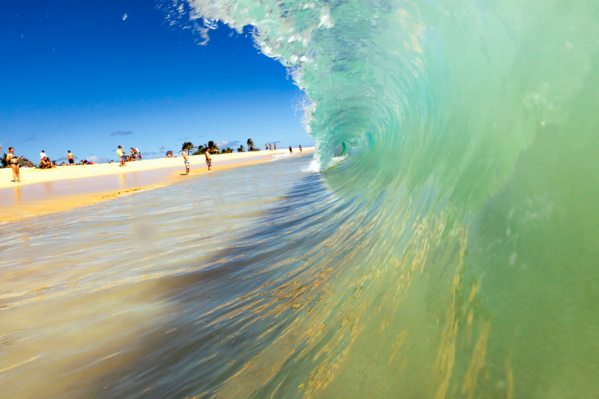 a photograph of the inside of wave barreling on the shore of sandy beach, oahu, hawaii