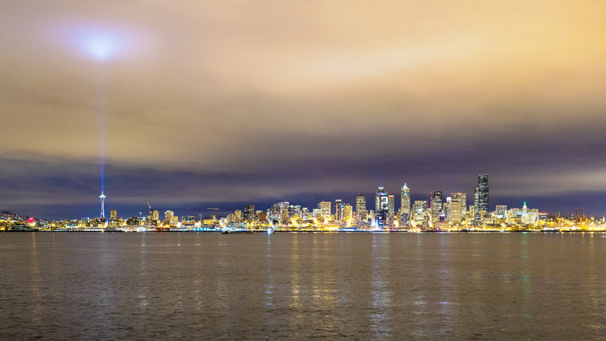 a photograph of the seattle skyline with the 12 on the russel investment center building