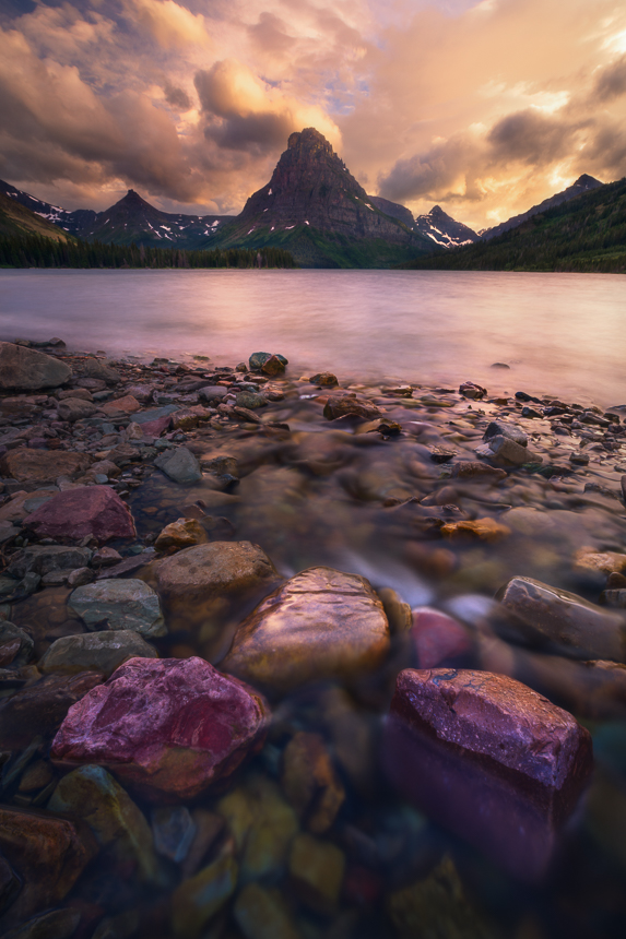 photo of a trio or rocks at two medicine lake in glacier national park