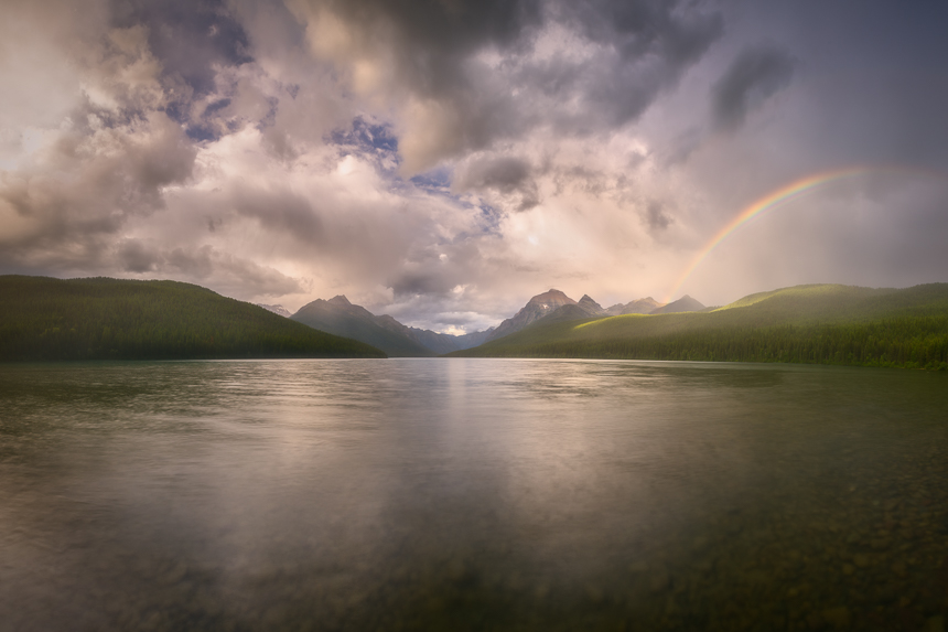 photo of a rainbow at bowman lake in glacier national park montana